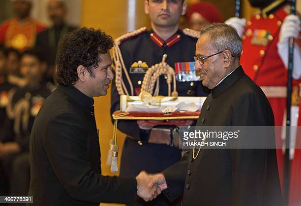 Indian cricketer Sachin Tendulkar shakes hands Indian President Pranab Mukherjee as he receives the 'Bharat Ratna' award during an awards ceremony at...