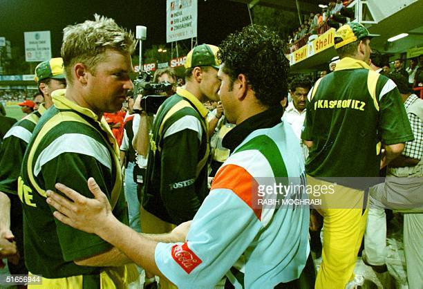 Indian cricketer Sachin Tendulkar shakes hands with Australian cricketers after the Indian victory against Australia in a final match in Sharjah 24...