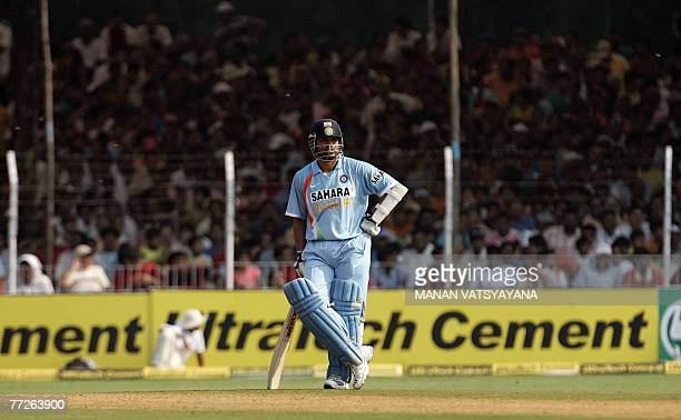 Indian cricketer Sachin Tendulkar stands alone on the pitch as he waits for the new batsman during the fifth oneday international match between India...