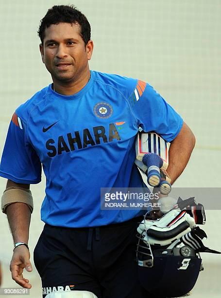 Indian cricketer Sachin Tendulkar walks back after a training session at the nets in Ahmedabad on November 14 2009 Tendulkar begins a third decade in...