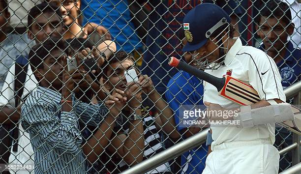Indian cricketer Sachin Tendulkar walks in to bat for his state team during the Ranji Trophy match between Mumbai and Railways at the Wankhede...
