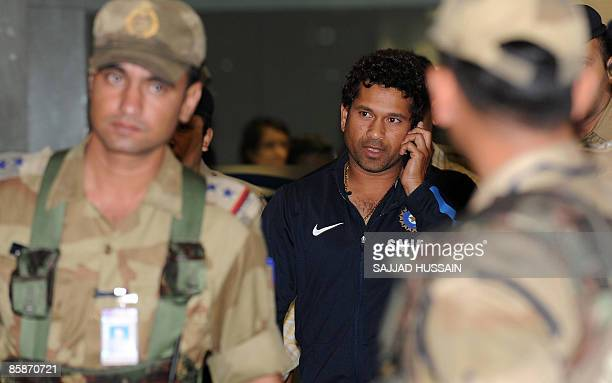 Indian cricketer Sachin Tendulkar walks out of the city airport after arriving from New Zealand in Mumbai late April 8 2009 The Indian cricket team...