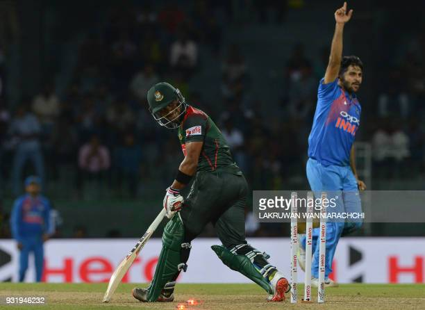 Indian cricketer Shardul Thakur celebrates after he dismissed Bangladesh cricketer Sabbir Rahman during the Fifth Match Nidahas Twenty20 TriSeries...