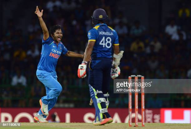 Indian cricketer Shardul Thakur celebrates after he dismissed Sri Lankan cricketer Niroshan Dickwella during the fourth one day international cricket...