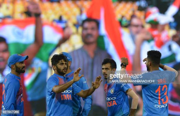 Indian cricketer Shardul Thakur celebrates with his teammates after he dismissed Bangladesh cricketer Sabbir Rahman during the Fifth Match Nidahas...