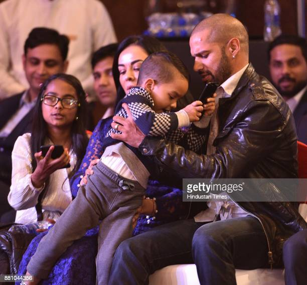 Indian Cricketer Shikhar Dhawan along with his family during an award function night organised by Bag Films Network at Taj Palace Hotel on November...