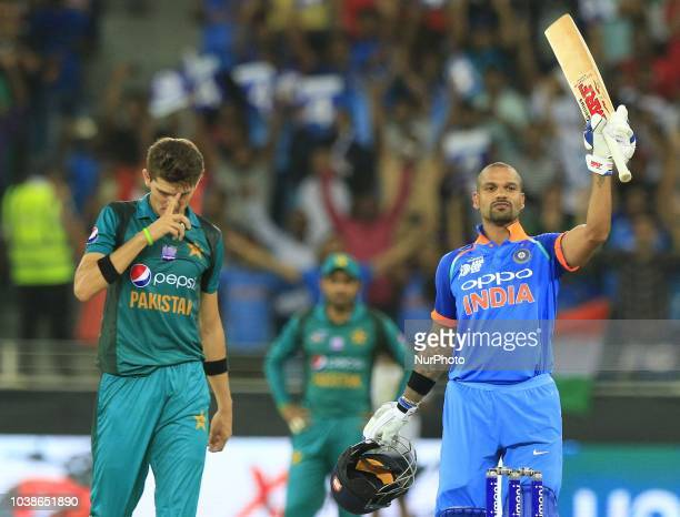 Indian cricketer Shikhar Dhawan celebrates after scoring 100 runs during the Asia Cup 2018 cricket match between India and Pakistan at Dubai...