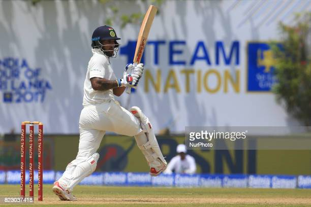 Indian cricketer Shikhar Dhawan plays a shot during the 1st Day's in the 1st Test match between Sri Lanka and India at the Galle International...