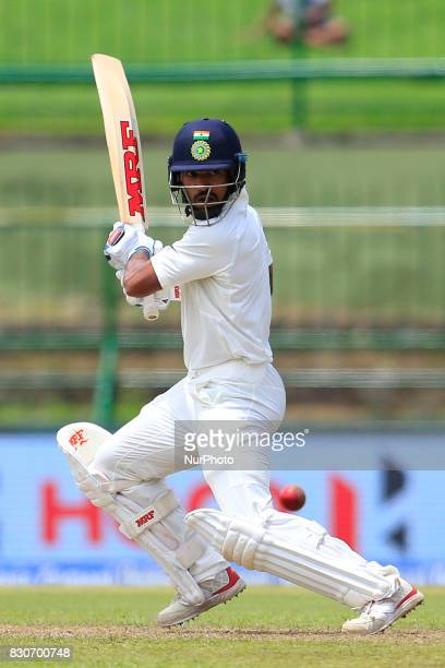 Indian cricketer Shikhar Dhawan plays a shot during the 1st Day's play in the 3rd Test match between Sri Lanka and India at the Pallekele...