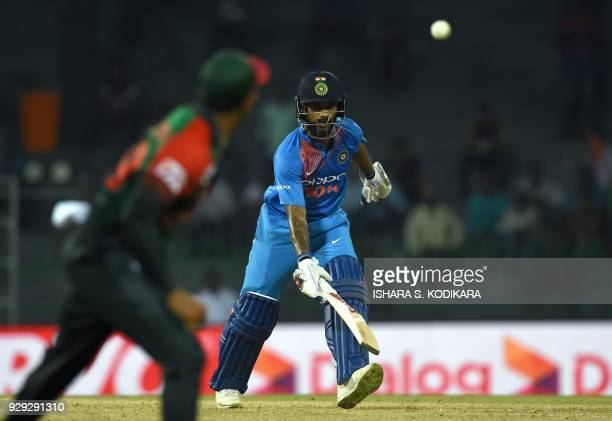 Indian cricketer Shikhar Dhawan runs between wickets during the second Twenty20 international cricket match between Bangladesh and India for the...