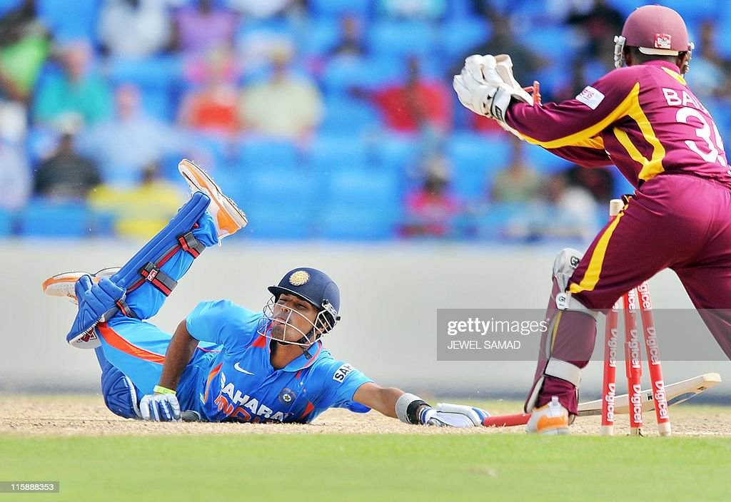 Indian Cricketer Subramaniam Badrinath Dives But Fail To Save His News Photo -8757