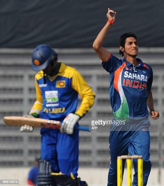 Indian cricketer Sudeep Tyagi celebrates the dismissal of Sri Lankan cricketer Upul Tharanga during the TriNation tournament One Day International...