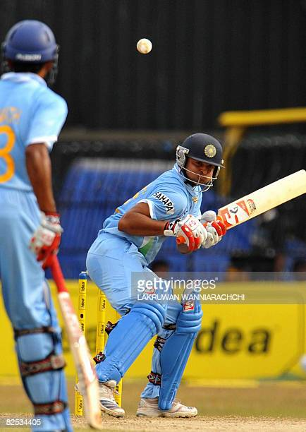 Indian cricketer Suresh Raina avoids a bouncer off the bowling of Sri Lankan pacer Thilina Thushara Mirando during the third One Day International...