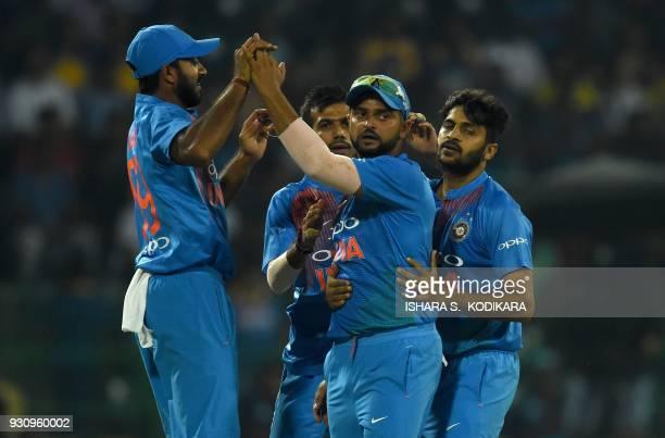Indian cricketer Suresh Raina celebrates with teammates after dismissing Sri Lankan cricketer Danushka Gunathilaka during the fourth Twenty20...