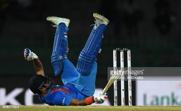 TOPSHOT Indian cricketer Suresh Raina dives into his crease to complete a run during the second Twenty20 international cricket match between...