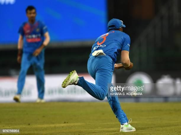 Indian cricketer Suresh Raina drops a catch off a shot played by Bangladesh cricketer Liton Das during the second Twenty20 international cricket...