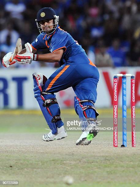 Indian cricketer Suresh Raina watches the ball as he prepares to bat during the Tri-Nation Championship Trophy final One Day International match...