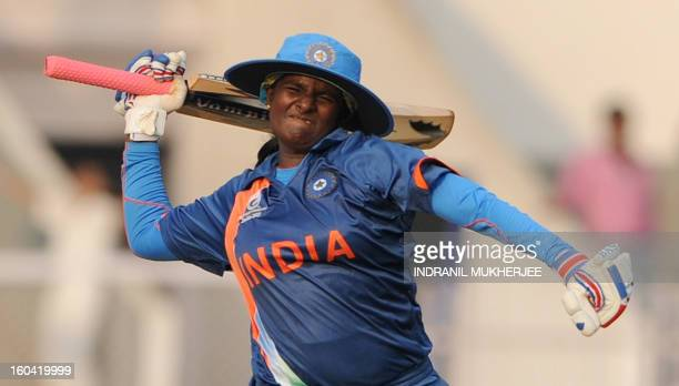 Indian cricketer Thirush Kamini celebrates her century during the inaugural match of the ICC Women's World Cup 2013 between India and West Indies at...