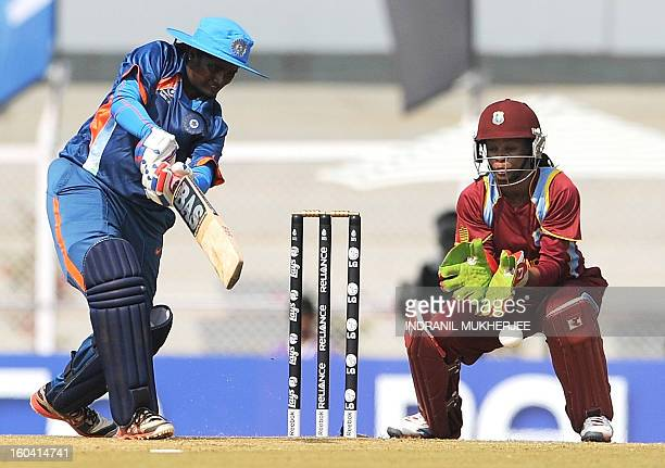Indian cricketer Thirush Kamini plays a shot as West Indian cricketer Merissa Aguelleria looks on during the inugural match of the ICC Women's World...
