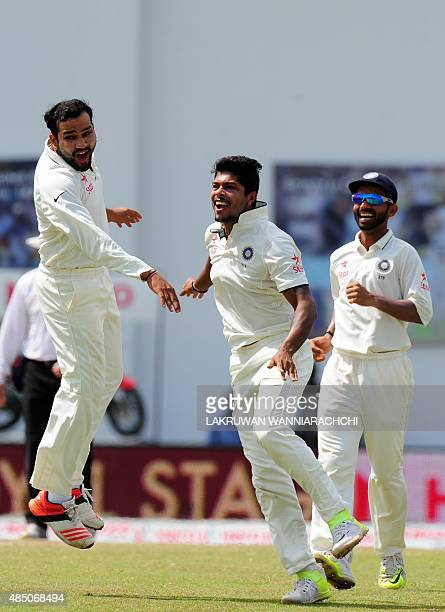 Indian cricketer Umesh Yadav celebrates with his teammates after he dismissed Sri Lankan cricket captain Angelo Mathews during the final day of the...