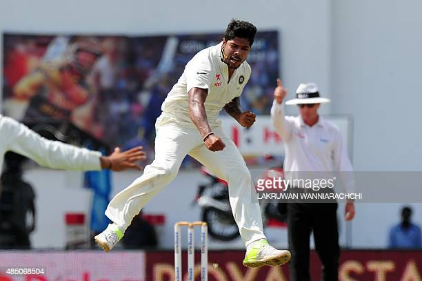 Indian cricketer Umesh Yadav leaps into the air after dismissing Sri Lankan cricket captain Angelo Mathews during the final day of the second Test...
