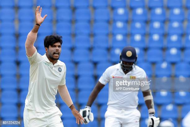 Indian cricketer Umesh Yadav unsuccessfully appeals for a Leg Before Wicket decision against Sri Lankan cricketer Angelo Mathews during the third day...