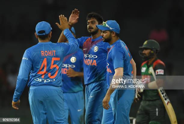 Indian cricketer Vijay Shankar celebrates with his teammates after he dismissed Bangladesh Cricket captain Mohammad Mahmudullah during the second...