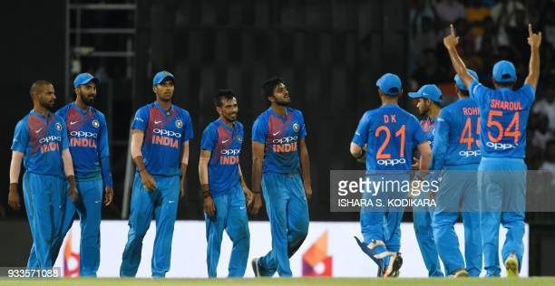 Indian cricketer Vijay Shankar celebrates with his teammates after he dismissed Bangladeshi cricketer Mahmudullah during the final Twenty20...
