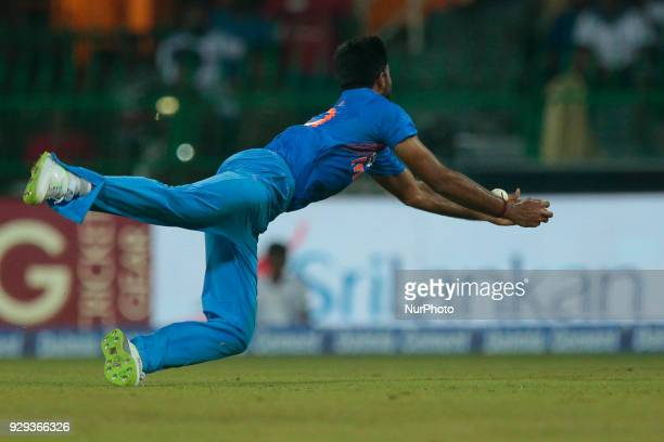 Indian cricketer Vijay Shankar reaches out in an unsuccessful attempt to take a catch during the 2nd T20 cricket match of NIDAHAS Trophy between...