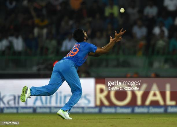 Indian cricketer Vijay Shankar tries to take a catch during the second Twenty20 international cricket match between Bangladesh and India of the...