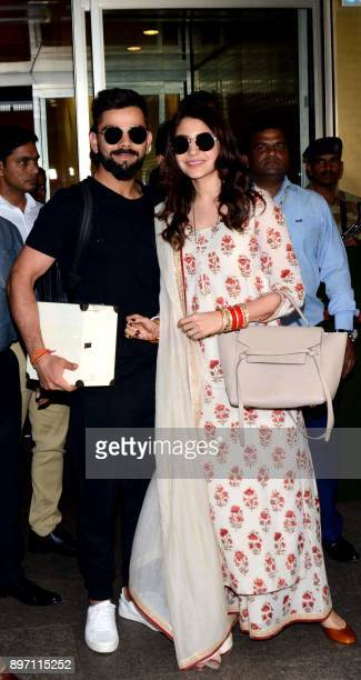 Indian cricketer Virat Kohli and Bollywood actress Anushka Sharma who were recently married in Italy arrive at the International Airport in Mumbai on...