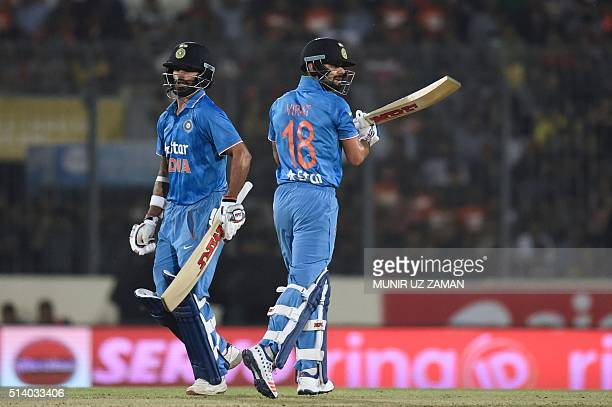 Indian cricketer Virat Kohli and Shikhar Dhawan run between the wickets during the Asia Cup T20 cricket tournament final match between Bangladesh and...
