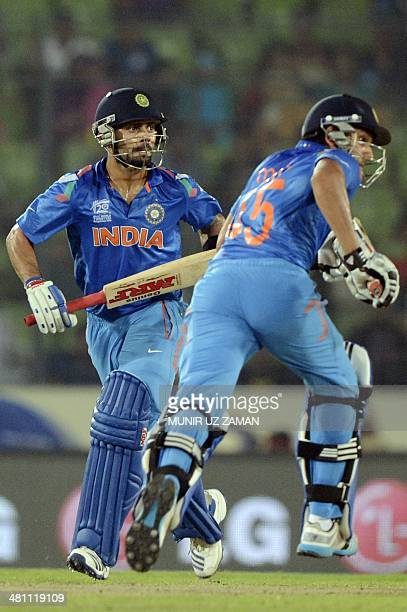 Indian cricketer Virat Kohli and teammate Rohit Sharma run between the wickets during the ICC World Twenty20 tournament Group 2 cricket match between...