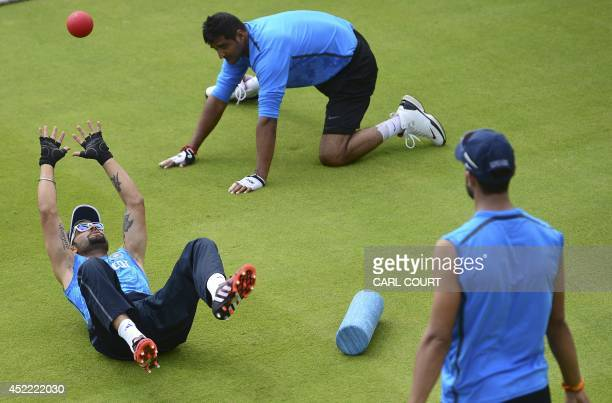 Indian cricketer Virat Kohli and teammates attend a training session at Lords cricket ground in London on July 16 ahead of the 2nd Test match against...