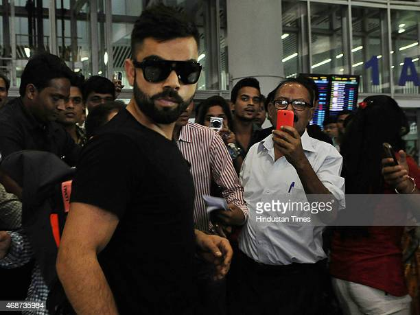 Indian cricketer Virat Kohli arrive with his girlfriend and Bollywood actress Anushka Sharma at NSCBIA Dum Dum Airport on April 6 2015 in Kolkata...