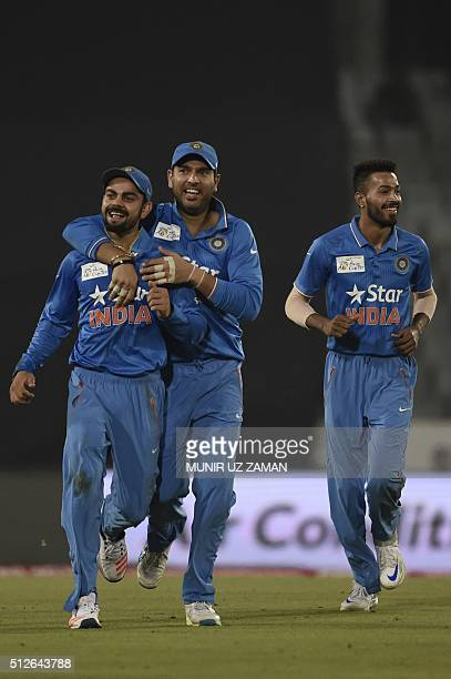 Indian cricketer Virat Kohli reacts after the dismissal of the Pakistan cricketer Khurram Manzoor during the match between India and Pakistan at the...