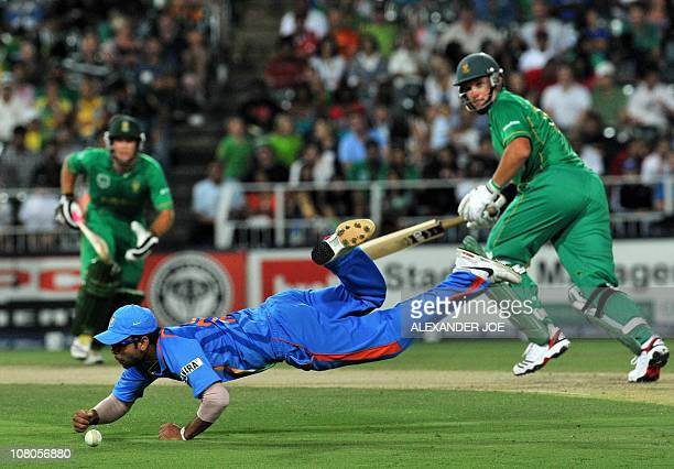 Indian cricketer Virat Kohli takes a dive to try and catch out South African Graeme Smith during the 2nd One Day International between India and...