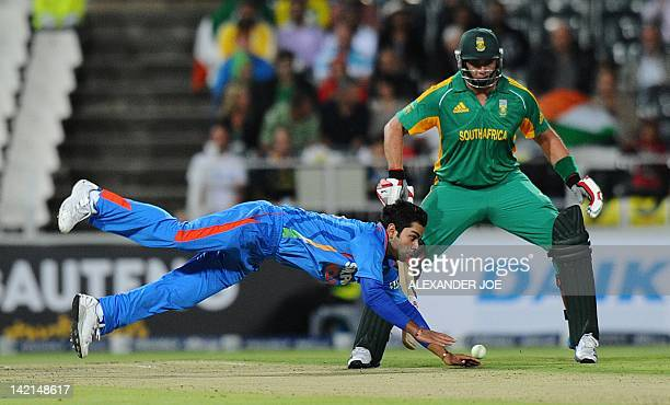 Indian cricketer Virat Kohli tries to run out South African batsman Colin Ingram during a oneoff T20 International between South Africa and India for...
