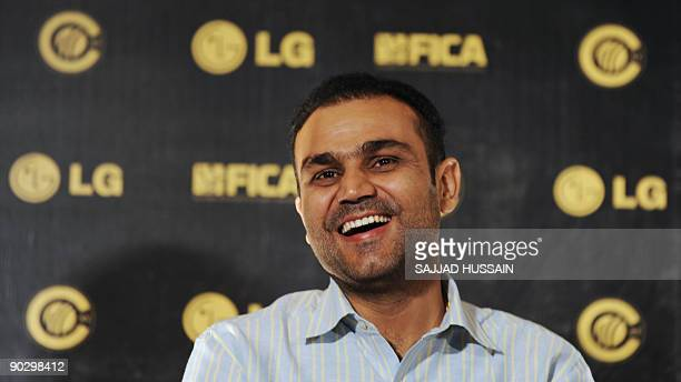 Indian cricketer Virender Sehwag gestures at a press conference to announce the nominees for LG ICC Awards 2009 in Mumbai on September 2 2009...