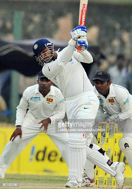 Indian cricketer Virender Sehwag is watched by Sri Lankan wicketkeeper Prasanna Jayawardene as he plays a stroke during the first day of the second...
