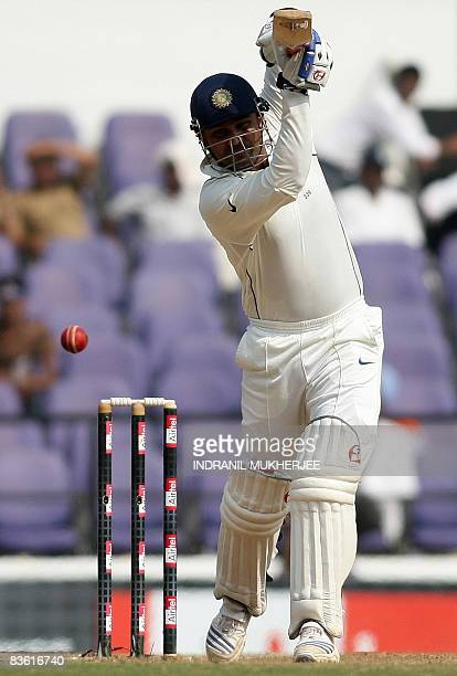 Indian cricketer Virender Sehwag plays a shot on the fourth day of the fourth and final Test match of the Border-Gavaskar Trophy 2008 series between...