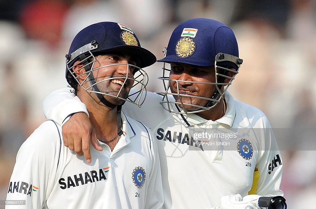 Indian cricketer Virendra Sehwag (R) sha : News Photo