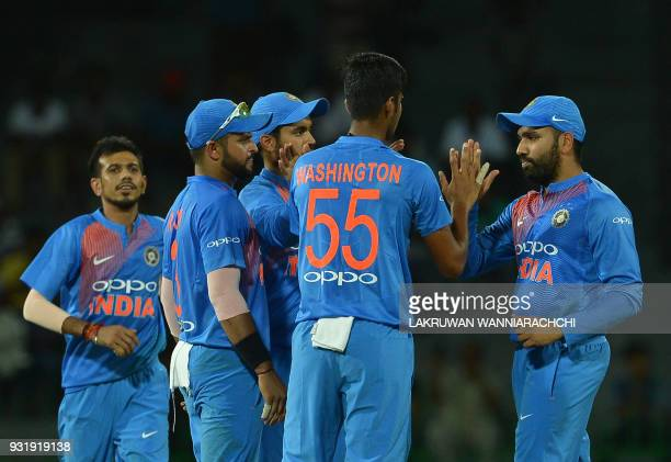Indian cricketer Washington Sundar celebrates with his teammates after he dismissed Bangladesh cricketer Soumya Sarkar during the fifth Twenty20...