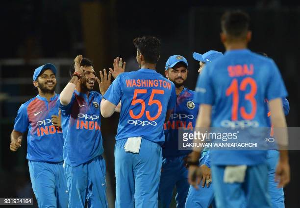 Indian cricketer Washington Sundar celebrates with his teammates after he dismissed Bangladesh cricketer Tamim Iqbal during the fifth Twenty20...