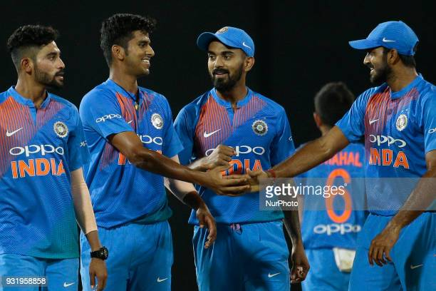 Indian cricketer Washington Sundar congratulated by his team members during the 5th Twenty20 cricket match of NIDAHAS Trophy between Bangladesh and...