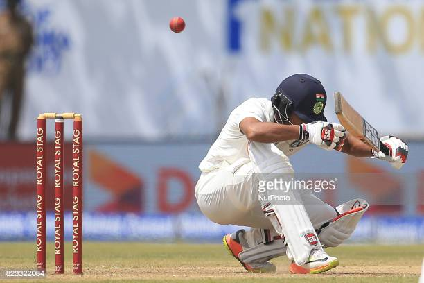 Indian cricketer Wriddhiman Saha ducks under a bouncer ball during the 2nd Day's play in the 1st Test match between Sri Lanka and India at the Galle...