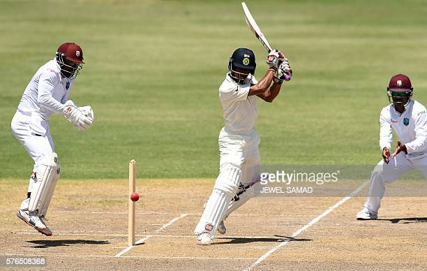 Indian cricketer Wriddhiman Saha plays a shot during Day 2 of the threeday tour match between India and WICB President's XI squad at the Warner Park...
