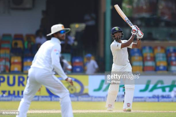 Indian cricketer Wriddhiman Saha plays a shot during the 2nd Day's play in the 2nd Test match between Sri Lanka and India at the SSC international...