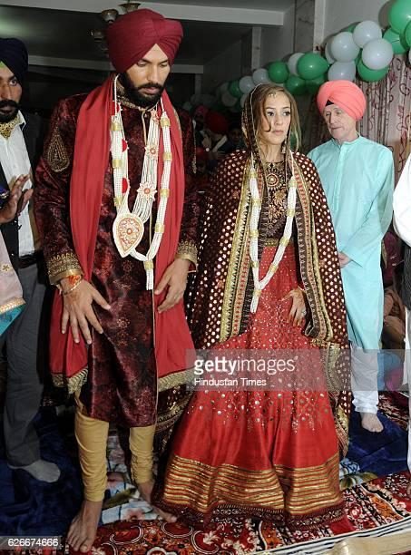 Indian cricketer Yuvraj Singh and actress Hazel Keech during their Anand Karaj at Dera Baba Ram Singh Gandua Wale in Fategarh Sahib District on...