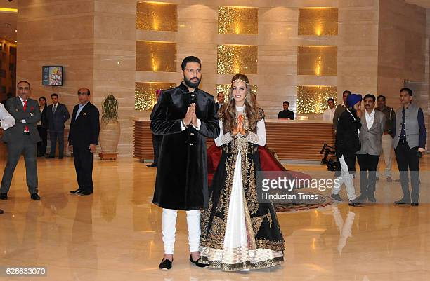 Indian cricketer Yuvraj Singh and actress Hazel Keech pose for photograph before their pre wedding Sangeet ceremony at The Lalit Hotel on November 29...